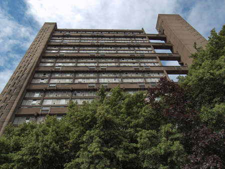hamlets: LONDON, ENGLAND, UK - JUNE 20, 2011: The Balfron Tower designed by Erno Goldfinger in 1963 is a Grade II listed masterpiece of new brutalist architecture