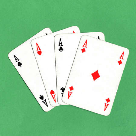 Game of cards with poker of aces over a green game table photo