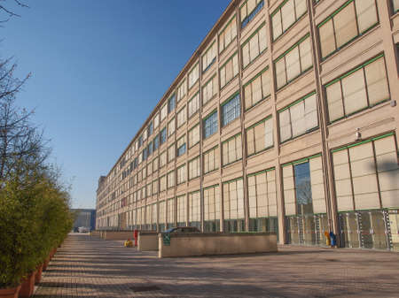 exhibition complex: TURIN, ITALY - JANUARY 24, 2014: The Fiat Lingotto car factory designed by Trucco in 1916 was the largest car factory at the time and still houses the Fiat directional centre and an exhibition complex Editorial