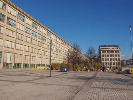 rationalist: TURIN, ITALY - JANUARY 24, 2014: The Fiat Lingotto car factory designed by Trucco in 1916 was the largest car factory at the time and still houses the Fiat directional centre and an exhibition complex Editorial