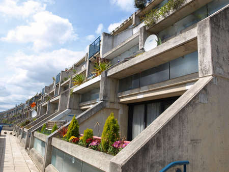 alexandra: LONDON, ENGLAND, UK - MAY 06, 2010: The Alexandra Road estate designed in 1968 by Neave Brown applies the terraced house model to high-density public housing is a masterpiece of new brutalist architecture