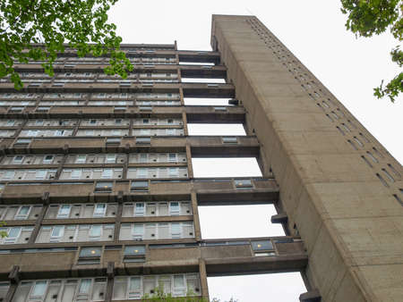 hamlets: LONDON, ENGLAND, UK - MAY 06, 2010: The Balfron Tower designed by Erno Goldfinger in 1963 is a Grade II listed masterpiece of new brutalist architecture