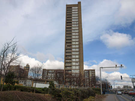 hamlets: LONDON, ENGLAND, UK - MARCH 05, 2009: The Balfron Tower designed by Erno Goldfinger in 1963 is a Grade II listed masterpiece of new brutalist architecture