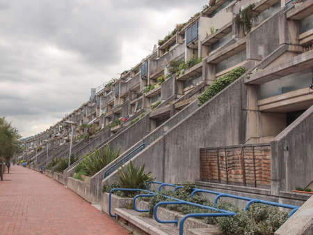 applies: LONDON, ENGLAND, UK - JUNE 20, 2011: The Alexandra Road estate designed in 1968 by Neave Brown applies the terraced house model to high-density public housing is a masterpiece of new brutalist architecture