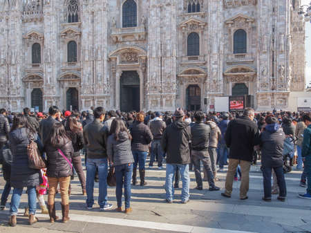 celebrated: MILAN, ITALY - FEBRUARY 23, 2014: People attending mass in front of Milan cathedral celebrated by Filipino Cardinal Luis Antonio Tagle Archbishop of Manila and Antonio Scola Archibishop of Milan