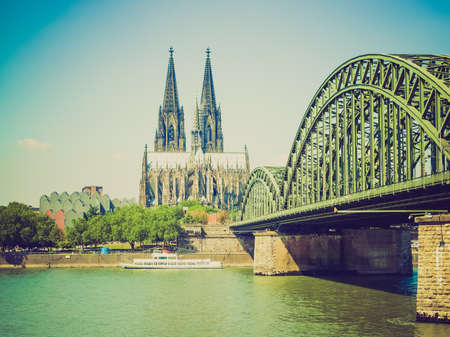 Vintage retro looking Koeln (Germany) panorama including the gothic cathedral and steel bridge over river Rhine photo