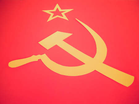 marx: Vintage retro looking Communist CCCP Flag with hammer and sickle, symbols of communism, yellow over red Stock Photo