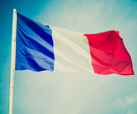 francais: Vintage retro looking Flag of France over a blue sky Stock Photo