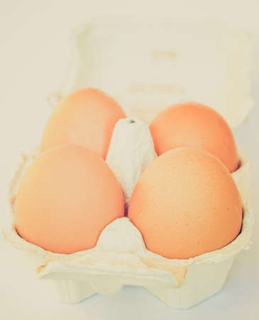 Vintage retro looking Four eggs in a cardboard wrap box