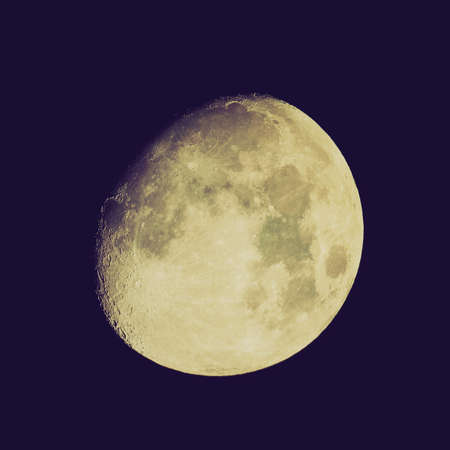 Vintage retro looking Moon almost full seen from the northern hemisphere with a telescope photo
