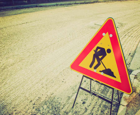 Vintage looking Road works traffic sign for construction site