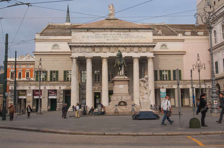 felice: GENOA, ITALY - MARCH 16, 2014: Tourists in front of Teatro Carlo Felice opera house designed by architect Aldo Rossi in 1991 following the destruction of the old theatre by fire