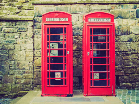 Vintage looking Traditional red telephone box in London, UK photo