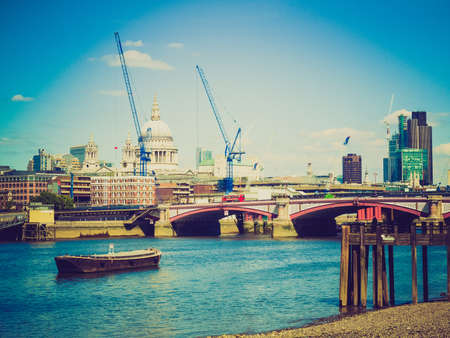 Vintage looking Panoramic view of River Thames, London, UK photo