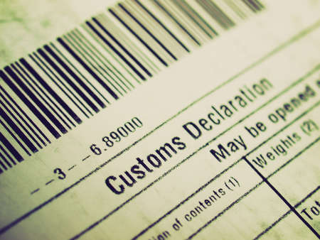 customs: Vintage looking Customs declaration on a foreign packet parcel Stock Photo