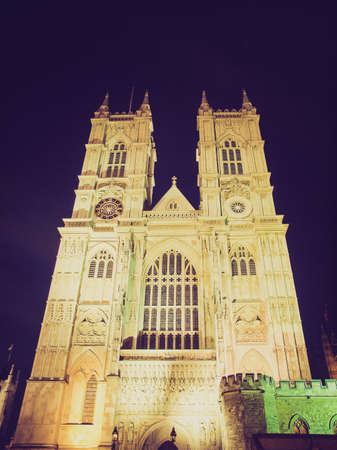 Vintage looking The Westminster Abbey church in London UK - night view photo