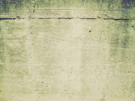 Vintage looking Raw concrete wall useful as a background photo