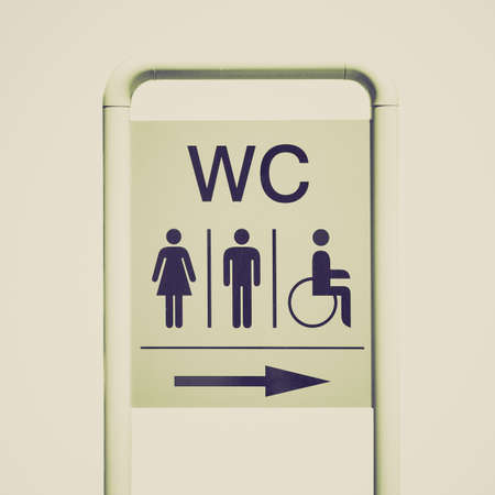 Vintage looking WC sign for ladies gentlemem and disabled isolated over white
