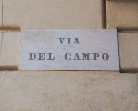 well made: Tourists visiting Via del Campo street made famous by Italian musician Fabrizio de Andre in a well known song