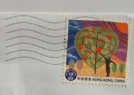A stamp printed by Chinese posts shows a drawing of a tree photo
