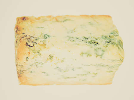 stilton: Vintage looking Blue Stilton cheese, traditional fine British food from the English Midlands Stock Photo