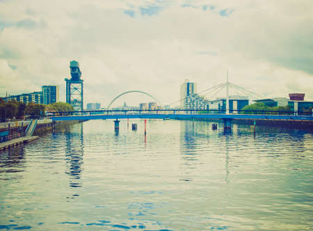 Vintage looking The River Clyde in Glasgow city, Scotland photo