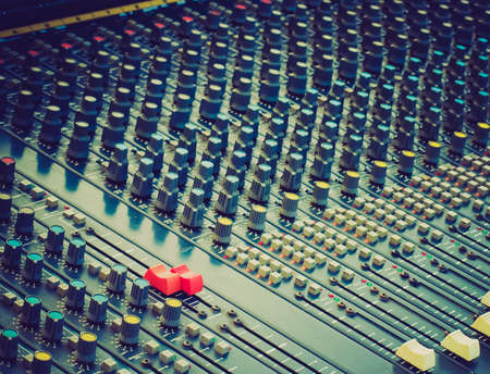 soundboard: Vintage looking Detail of a soundboard mixer electronic device