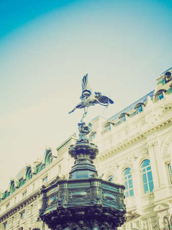 eros: Vintage looking Piccadilly Circus with statue of Anteros aka Eros in London, UK