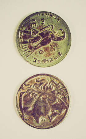 greek coins: Vintage looking Ancient Greek coin on a clear background Stock Photo
