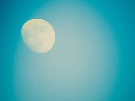 Vintage looking Full moon over the blue sky - with copyspace photo