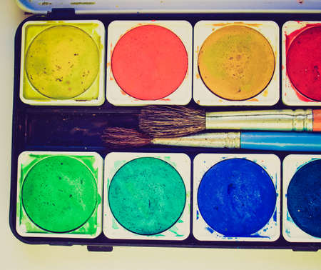 tempera: Vintage looking Painting tools colour palette and brushes Stock Photo