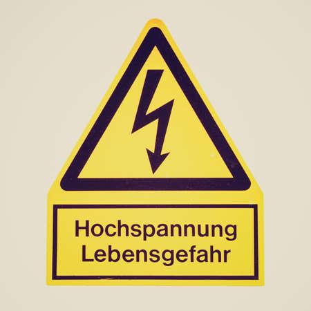 electrocution: Vintage looking Signal of danger of death by electrocution following an electric shock - in German: Hochspannung Lebensgefahr