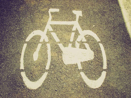 Vintage looking Stencil bike sign in black over white photo