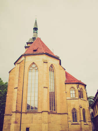 Vintage looking Stiftskirche Church in Schillerplatz, Stuttgart, Germany photo