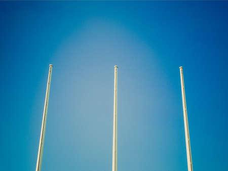 flagstaff: Vintage looking Flagpole flagstaff mast over a blue sky background Stock Photo