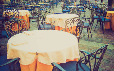 alfresco: Vintage looking Tables and chairs of a dehors alfresco bar restaurant pub