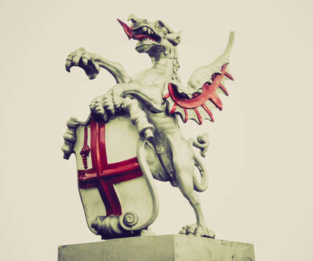 Vintage looking St George with the dragon, symbol of England and London photo