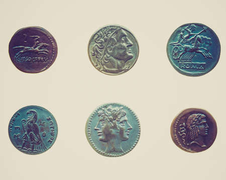 greek currency: Vintage looking Ancient Roman and Greek coins isolated over white