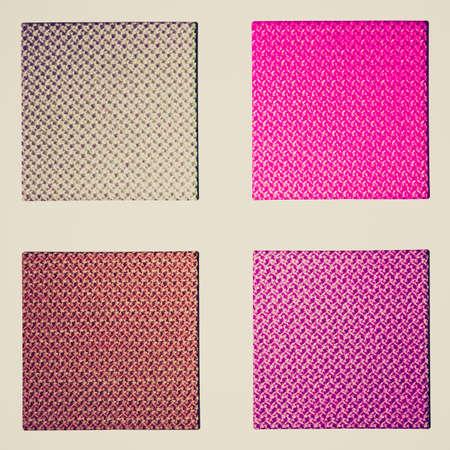 sampler: Vintage looking Colour fabric sampler over a white background