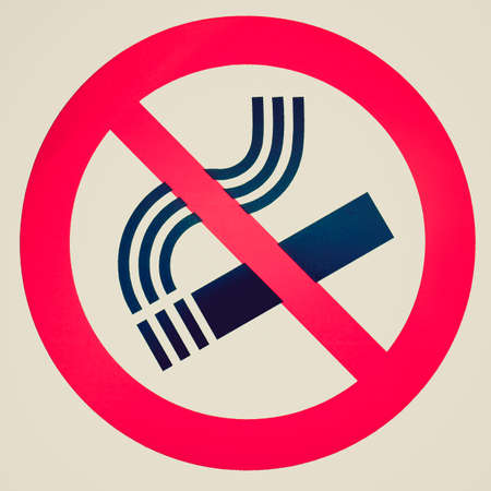 Vintage looking No smoking sign isolated over white background photo