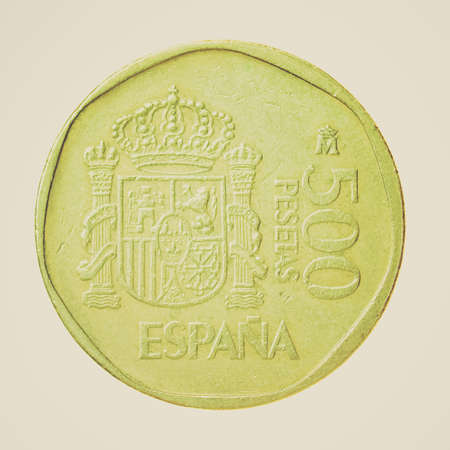 Vintage looking Vintage Spanish coin isolated over a white background photo
