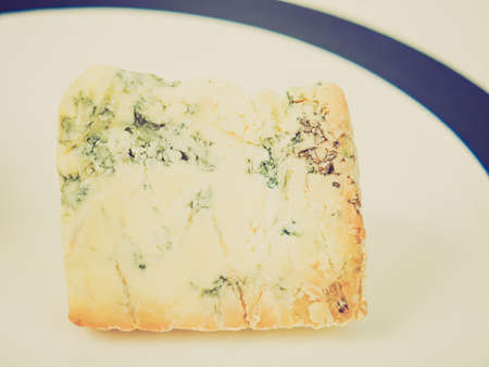 stilton: Vintage looking Blue Stilton cheese, traditional fine British food from the English Midlands - in a dish
