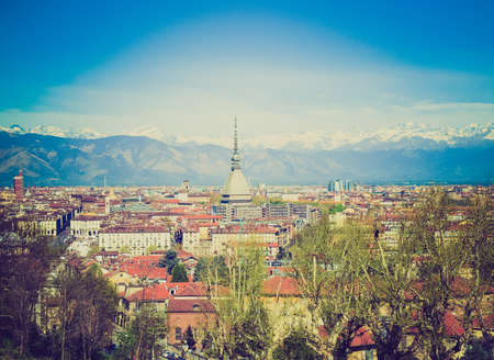 Vintage looking City of Turin (Torino) skyline panorama seen from the hill photo