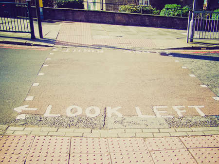 look at right: Vintage looking Look right look left sign on London zebra crossing