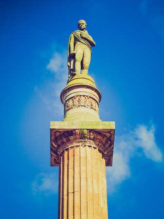 Vintage looking Sir Walter Scott column in George Square, Glasgow