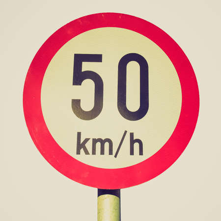 kilometres: Vintage looking Traffic speed limit sign isolated over white