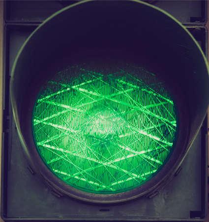 authorisation: Vintage looking Green light on a traffic light or semaphore Stock Photo