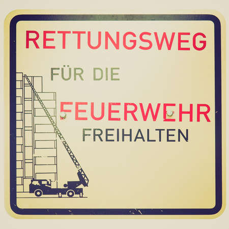 Vintage looking Firefighters sign (in German) isolated on white photo