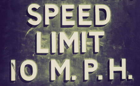 mph: Vintage looking A traffic sign speed limit 10 mph