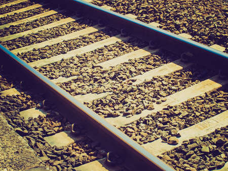 Vintage looking Detail of railway railroad tracks for train photo
